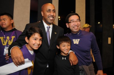 Coach Romar poses with fans