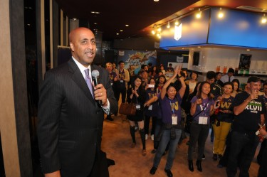 Coach Romar addresses the crowd