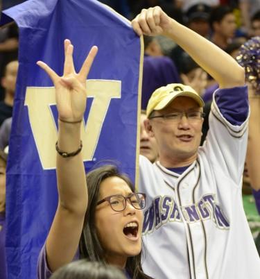 UW fans cheer on the Huskies