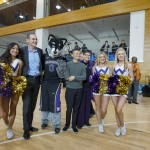 The UW Cheer Squad and Harry the Husky with Pac-12 Commissioner Larry Scott, Jack Ma and Ana Mari Cauce