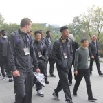 Members of the UW Men's Basketball Team tour Alibaba with founder Jack Ma.