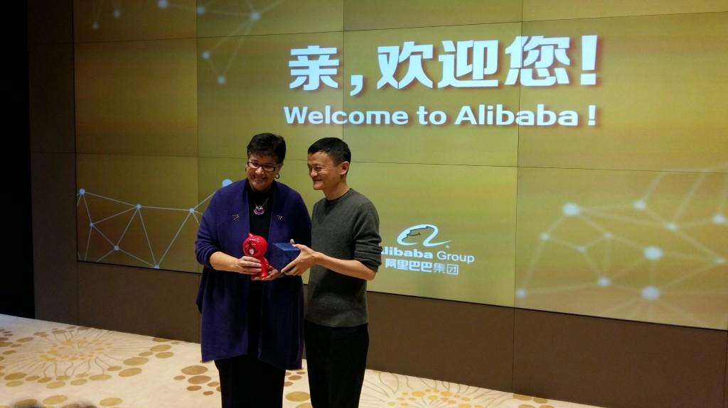 Alibaba founder Jack Ma welcomes President Ana Mari Cauce.