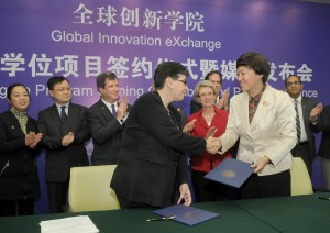 UW President Ana Mari Cauce shakes hands with Tsinghua University Chairperson Chen Xu after signing an agreement Nov. 9 creating a dual degree program within the Global Innovation Exchange (GIX).Dan Schlatter