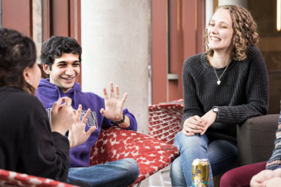 three UW students sitting and chatting