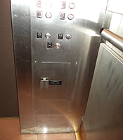 elevator emergency phone located under elevator floor buttons