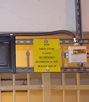 fire alarm speaker next to text reader board