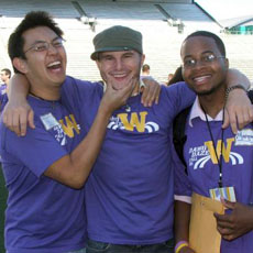 Three male students smiling at camera