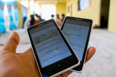 Mobile phones display the CG Net Swara app