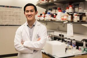 Portrait of Caleb Perez in his lab