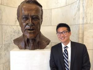 Benjamin Lee poses with a sculpture of Senator Jackson.