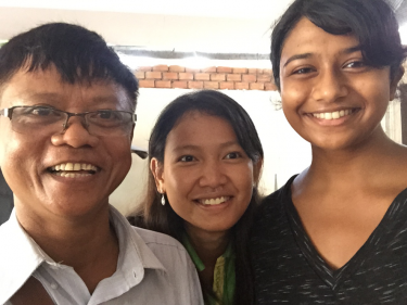 Varsha poses with her language teachers.