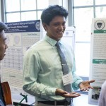 Student presents his research in a poster presentation
