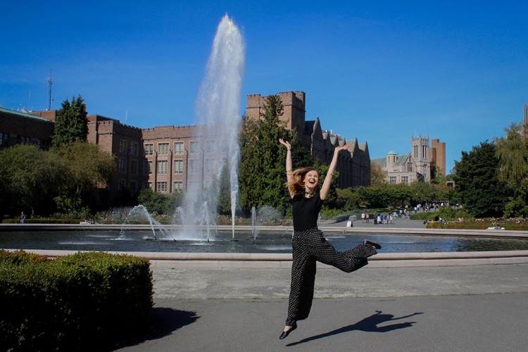 Melissa Krook jumping in front of fountain