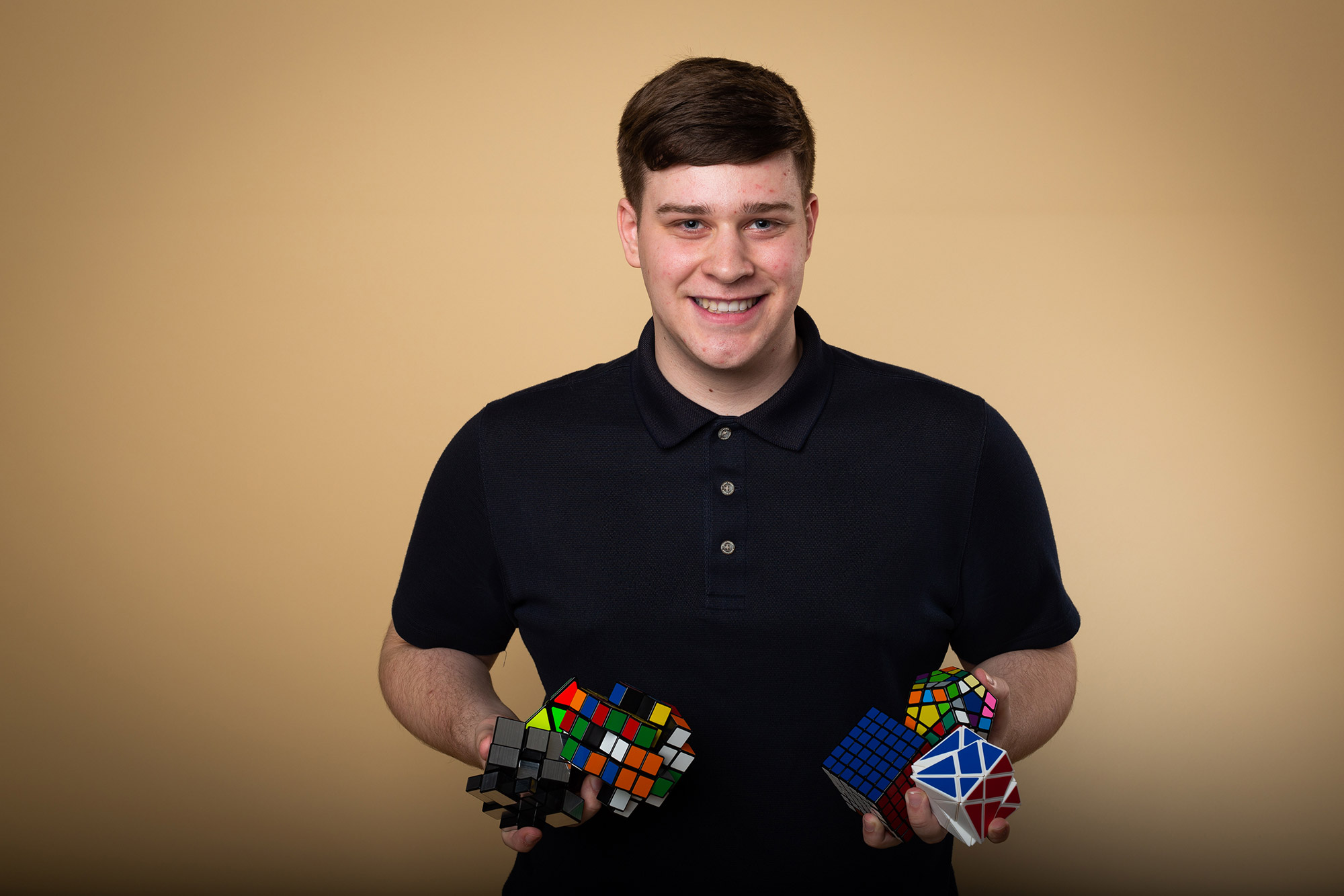 Jason Wien holds Rubik's cube type games