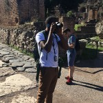 Student taking pictures in the Roman Forum.