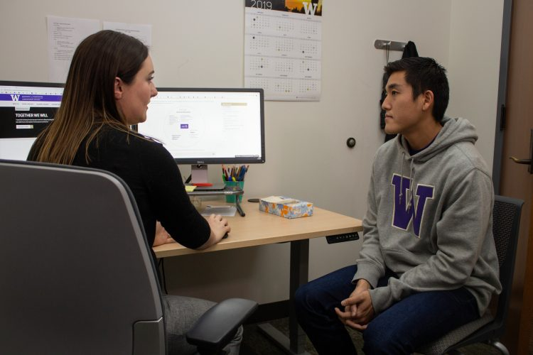 Adviser talks with undergraduate student
