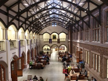 Photo of Mary Gates Hall commons with students studying.