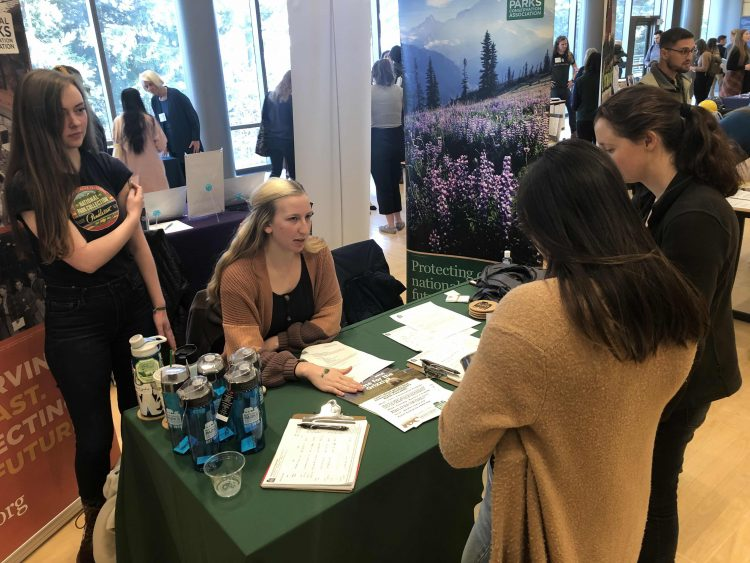 Photo of McKenzie Carlson and Rhyannon Hayes at tabling event.