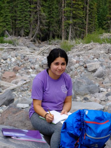 Photo of a student with her field journal.