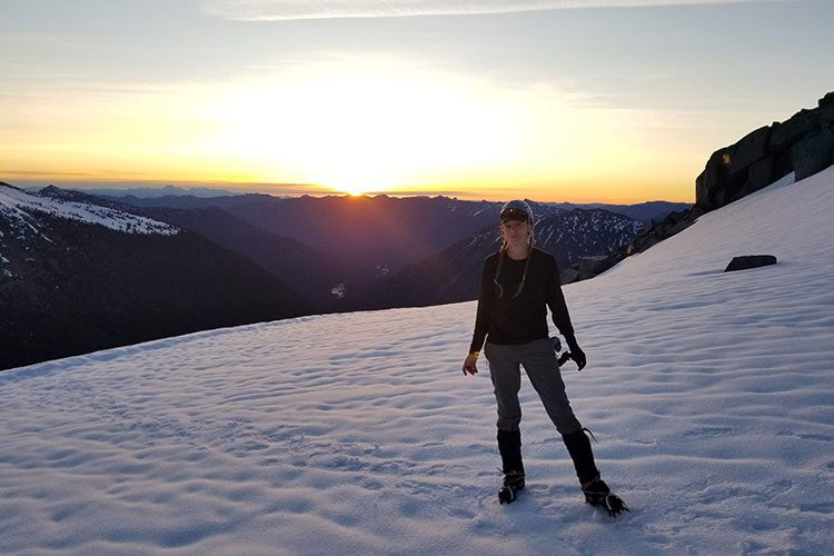 Virginia Burton stands in a snowy, mountain landscape.