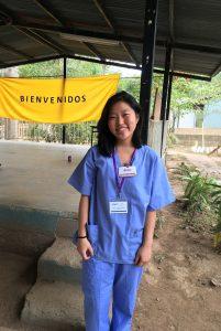 Photo of Kylee-Ann Tawara in medical scrubs in Honduras
