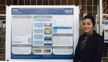 Photo of Maha Alhomoud in front of her research poster