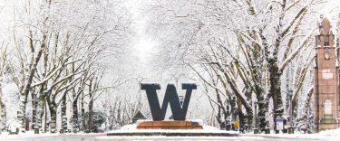 photo of the main UW entrance roadway covered in snow