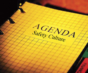 "picture of a 3-ring binber with cover page noting ""Agenda:"