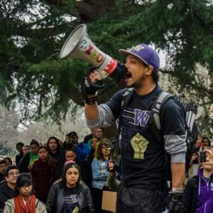 Michael leading the 2015 Black Lives Matter walk out on UW's campus.