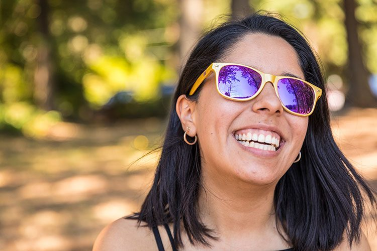 UW student with purple and gold sun glasses