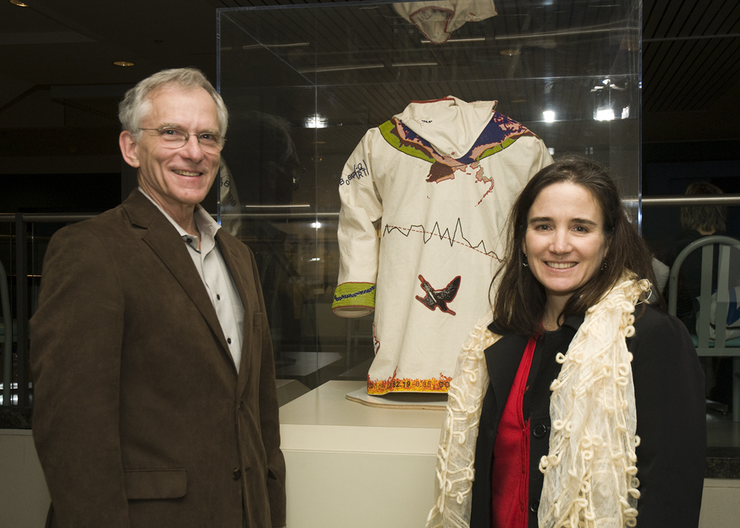 Robert Houze and Cecilia Bitz of atmospheric sciences, with 'The Melt,' created by Scott Schuldt and Bitz, beadwork on a canvas anorak that represents Bitz's research in the Arctic. Not shown is their colleague, Miles Logsdon. | Photo by Mary Levin.
