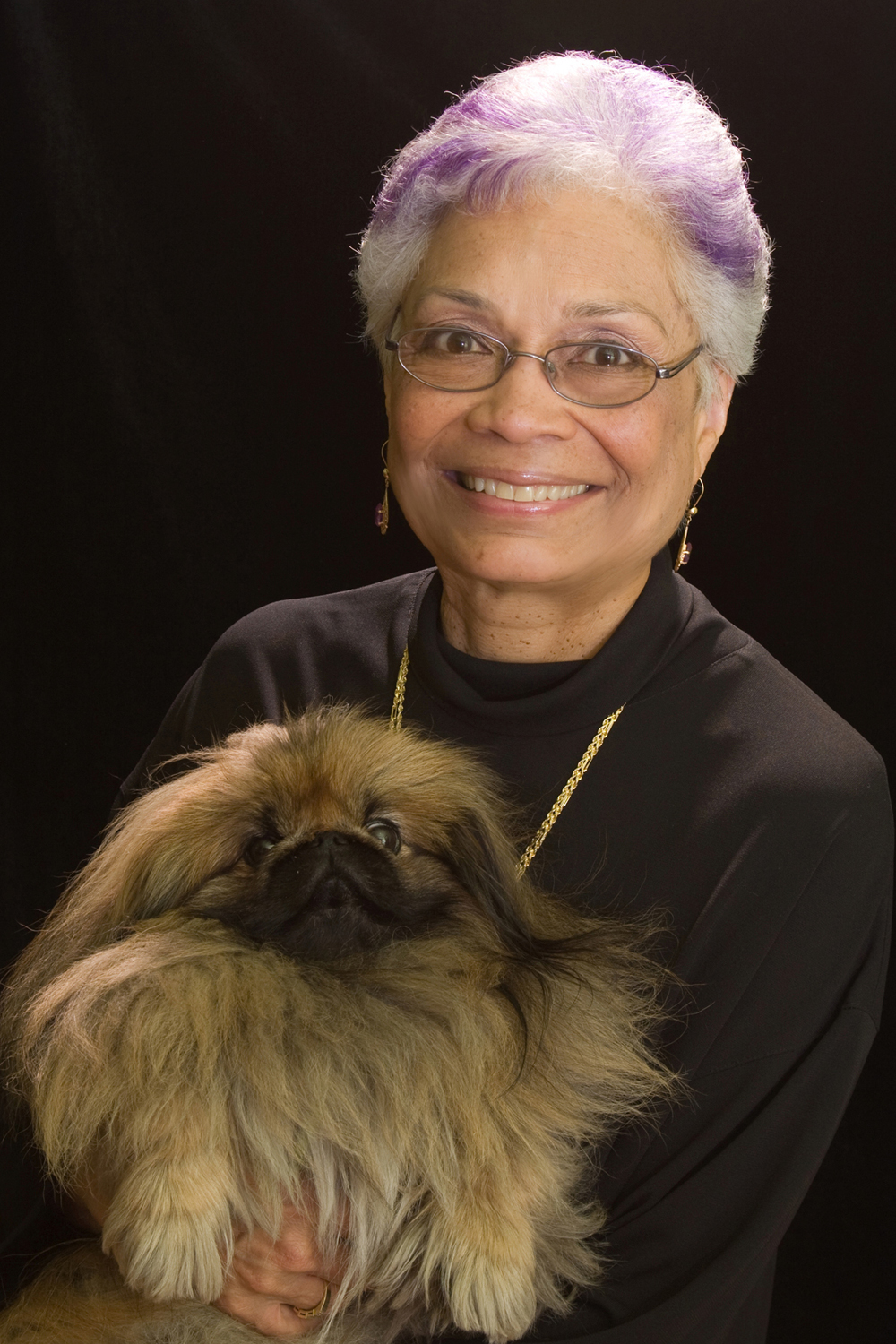 Sharon E. Sutton, with her Pekingese dog, Shoshana.