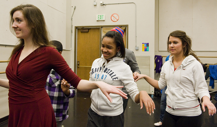 Amazing Grace teacher Michelle Zimmerman leads her student Ayanna Beavers and UW student Jacqueline Guyette. | Photo by Kathy Sauber