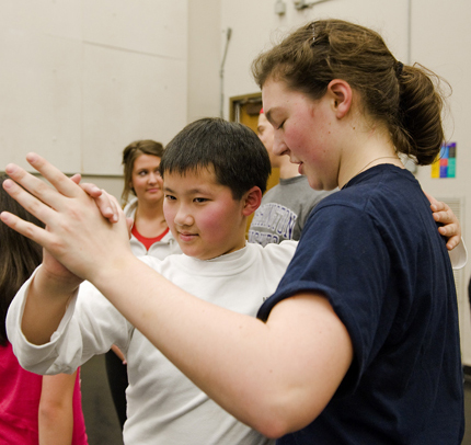 UW student Ruth Sackmann dances with Amazing Grace student Anton Nguyen. | Photo by Kathy Sauber