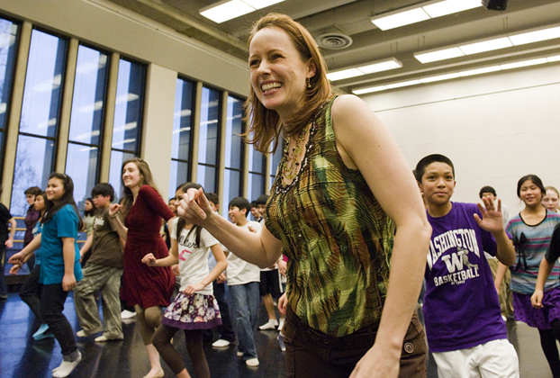 UW Dance Professor Juliet McMains leads a group of students from Amazing Grace Christian School in a lively dance.   Photo by Kathy Sauber