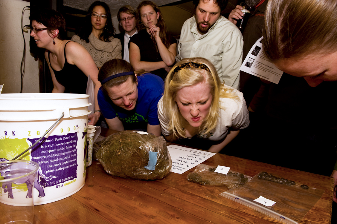 Contestants inspect and even smell the poop samples in order to answer the question. | Photo by Kathy Sauber