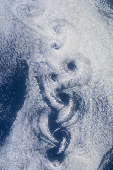 A 2001 photo from the space shuttle shows a phenomenon called von Karman vortices in clouds downwind from Rashiri Island in the northern Sea of Japan. The vortices are similar to those that form in superfluids.