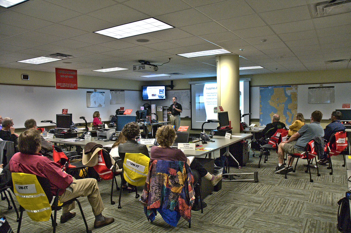 Steve Charvat, director of UW Emergency Management, talks with a group of employees from Environmental Health & Safety.