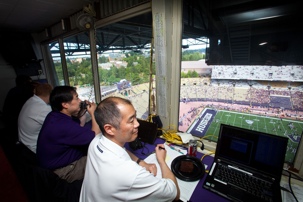 From left, Dan Lepse, Gary Heyamoto and Craig Heyamoto look down on the field shortly before kickoff at the Cal versus UW football game Sept. 24.