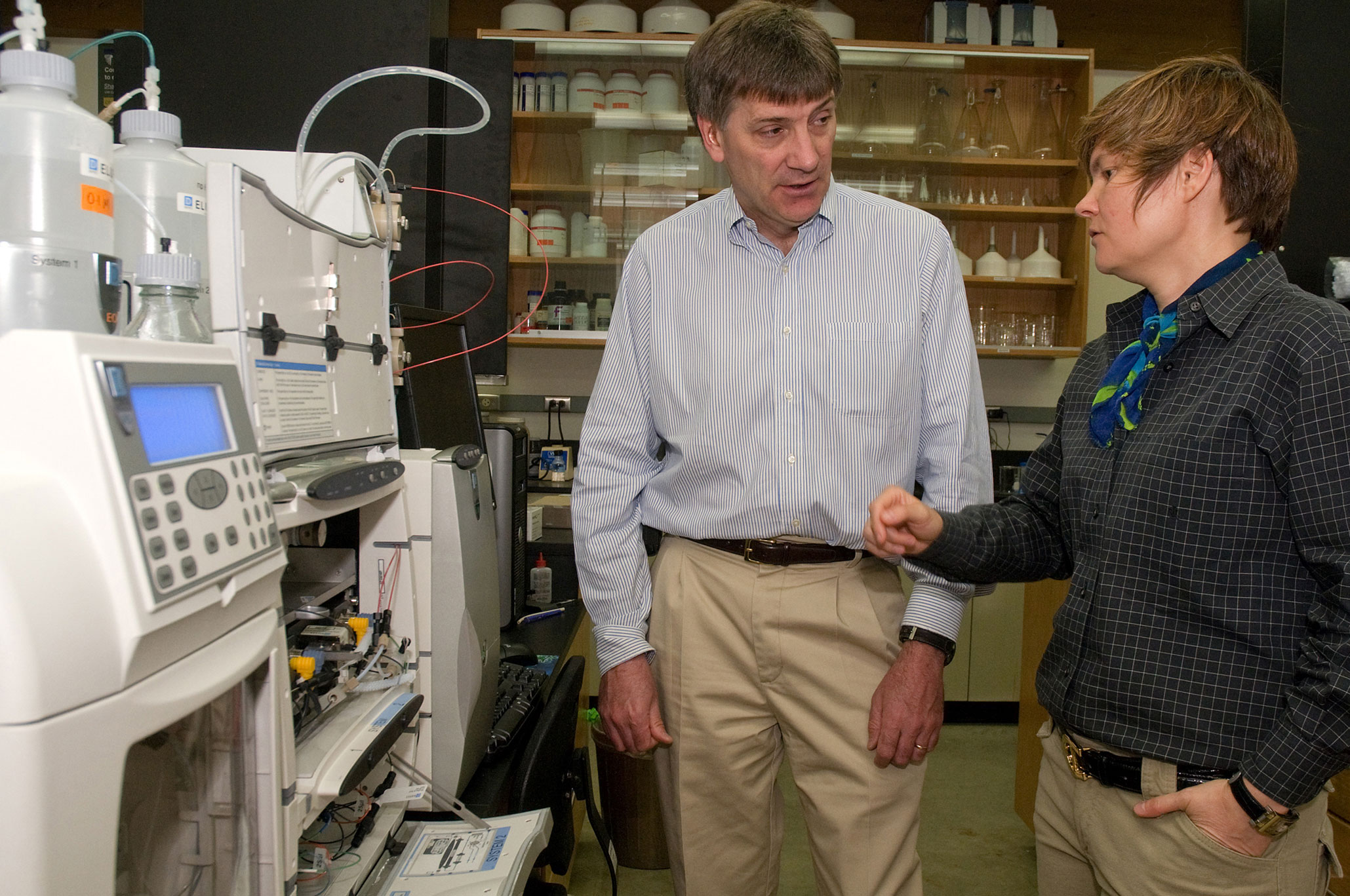 University of Washington faculty members Richard Gustafson and Renata Bura talk in the campus biofuels and bioresources laboratory about using a high-pressure liquid chromatographer to measure sugars extracted from biomass and to analyze the characteristics of fuels and chemicals made from those sugars.