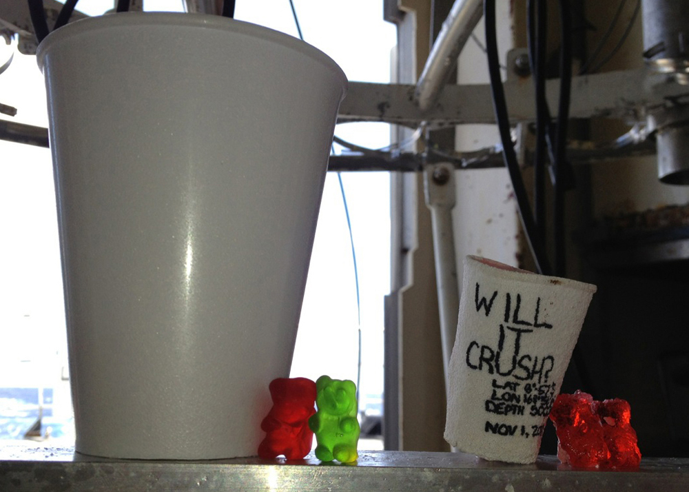 Compared to the Styrofoam cup on the left that stayed topside, the cup sent into the ocean depths collapsed under the pressure to about a quarter of its original size. The gummy bears didnt compress nearly as much, but look worse for the wear after their trip to the bottom.