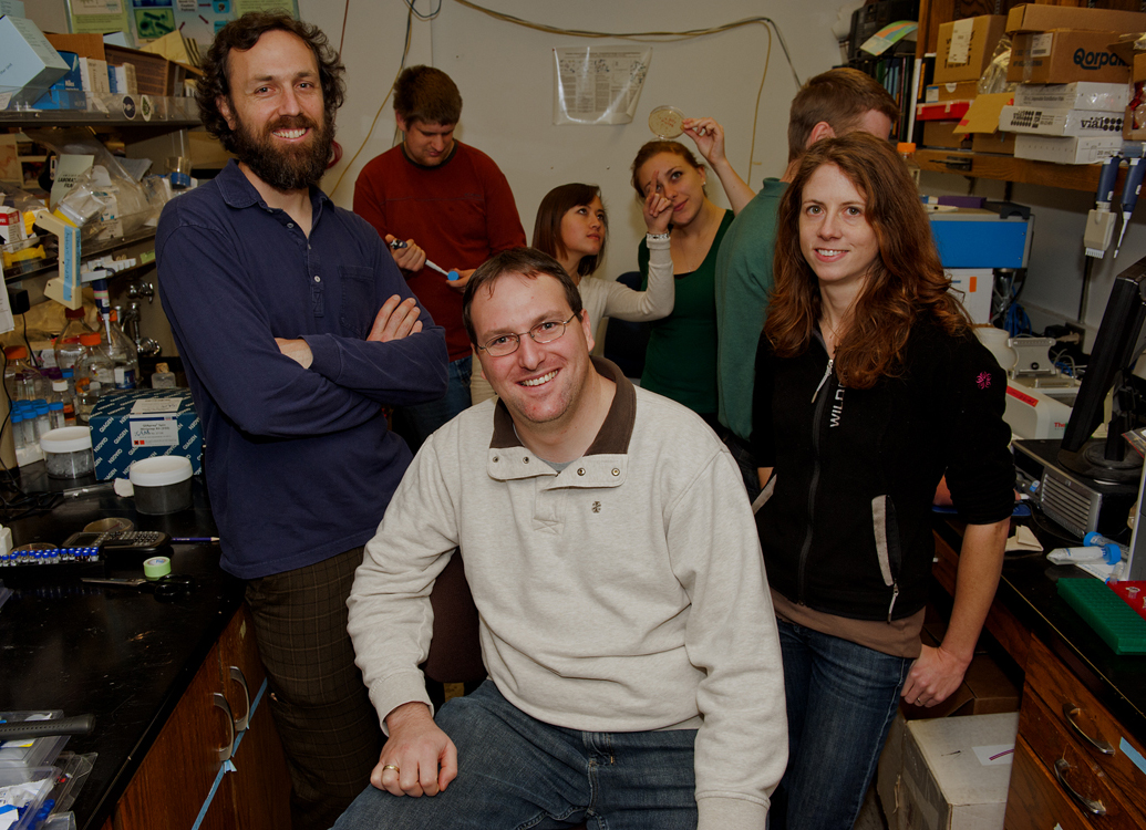 In foreground, from left, are advisers Rob Egbert, Justin Siegel and Ingrid Swanson Pultz, who mentored the iGEM team. In the back are team members Mathew Harger, Sydney Gordon and Liz Stanley.