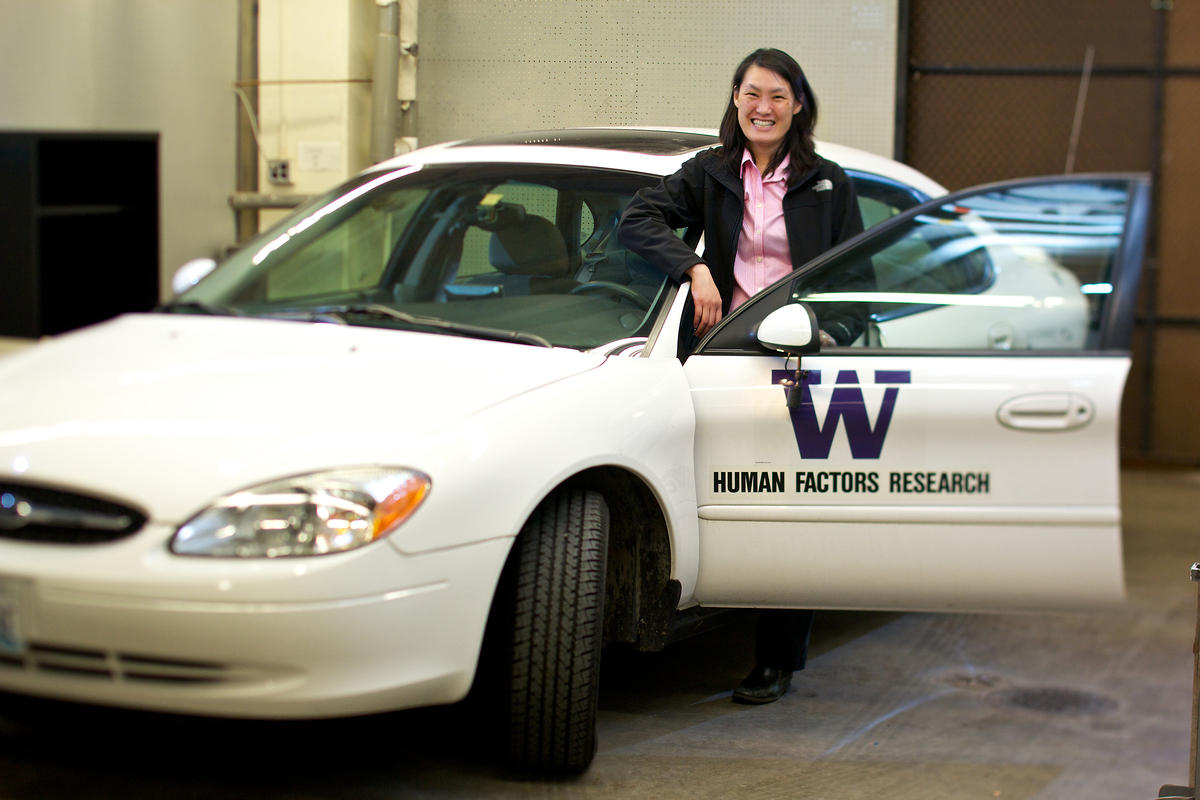 Linda Boyle with a car that measures a driver's attention, behavior and performance for her research on driver distraction.