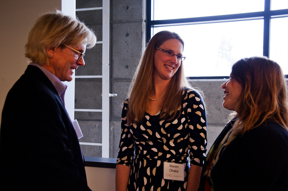 An invited guest talks with the Center for Commercializations Maren Ohaks, associate director of New Ventures, and Linden Rhoads, UW vice provost for commercialization.