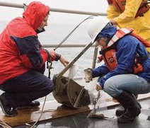 Jan Newton and oceanography graduate student at work on UW's vessel.