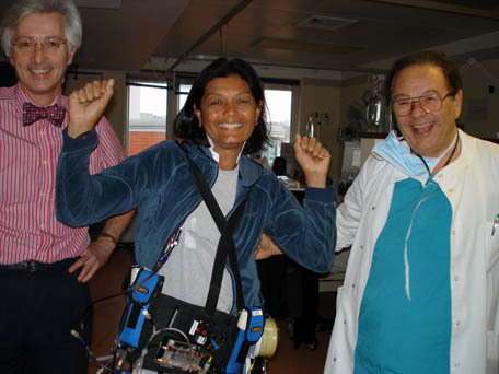 A woman models a prototype of a wearable artificial kidney. On the right is the inventor of the device, Dr. Victor Gura of UCLA.