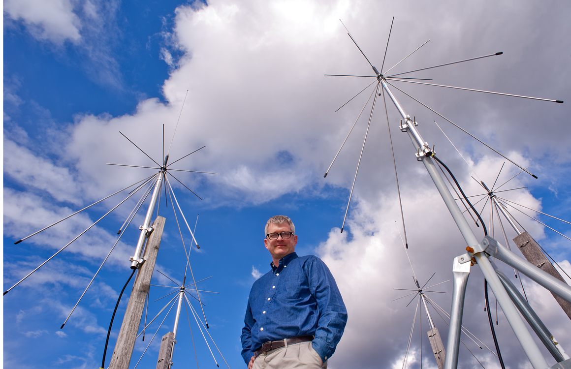 John Sahr with the passive radars on the roof of Sieg Hall. His group uses the radars to eavesdrop on FM radio stations in order to study the ionosphere.