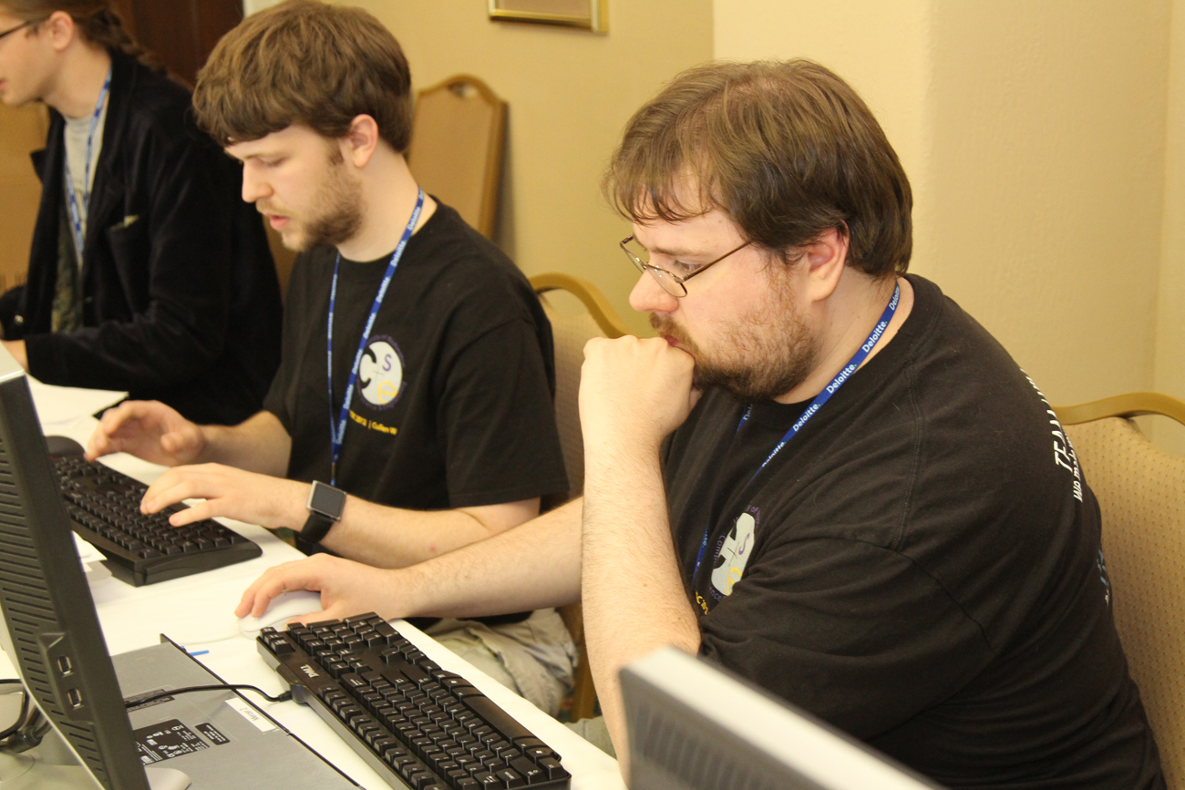 Landon Meernik (background), Cullen Walsh and Karl Koscher at this year's competition.