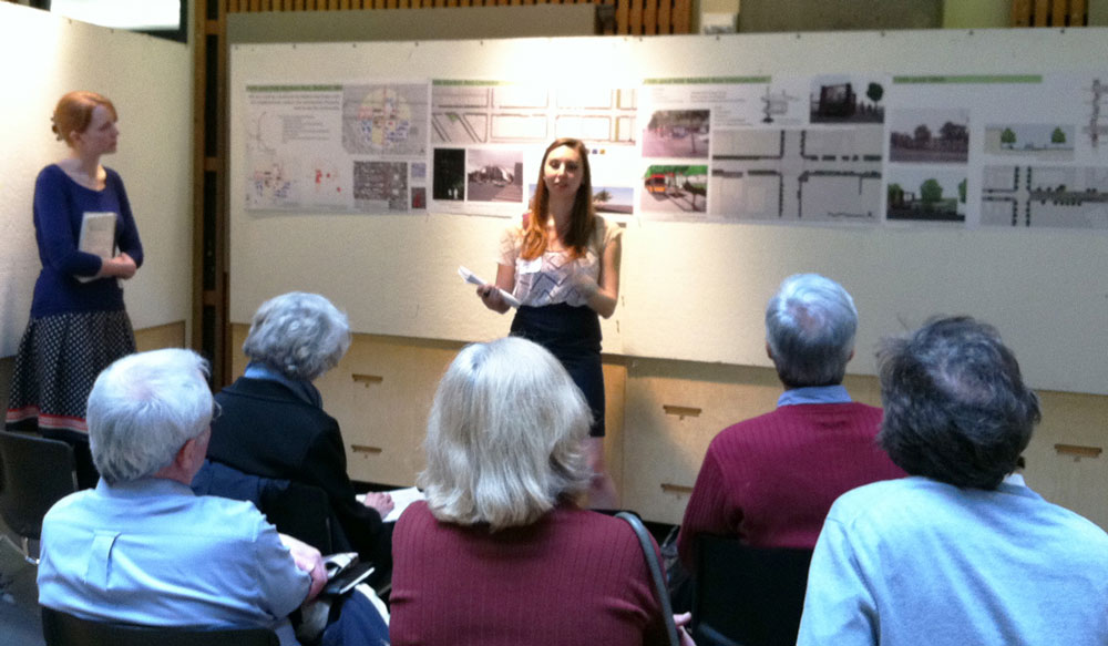 At a presentation in Gould Hall, students Alanagh Gannon (left) and Emily Griffith explain their design proposals for the area around the Market and Northeast 15th Street Rapid Ride station.