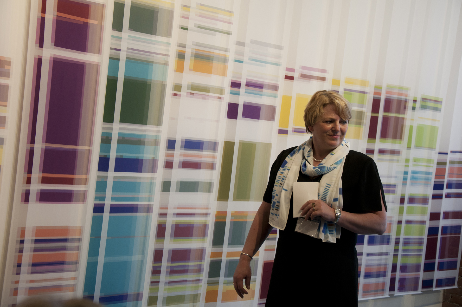Robin Bennett, UW Genetic Medicine Clinic co-director, wears a Chromosome 17 silk scarf in front of the Chromosome Painting studio installation by Geraldine Ondrizek, 2012